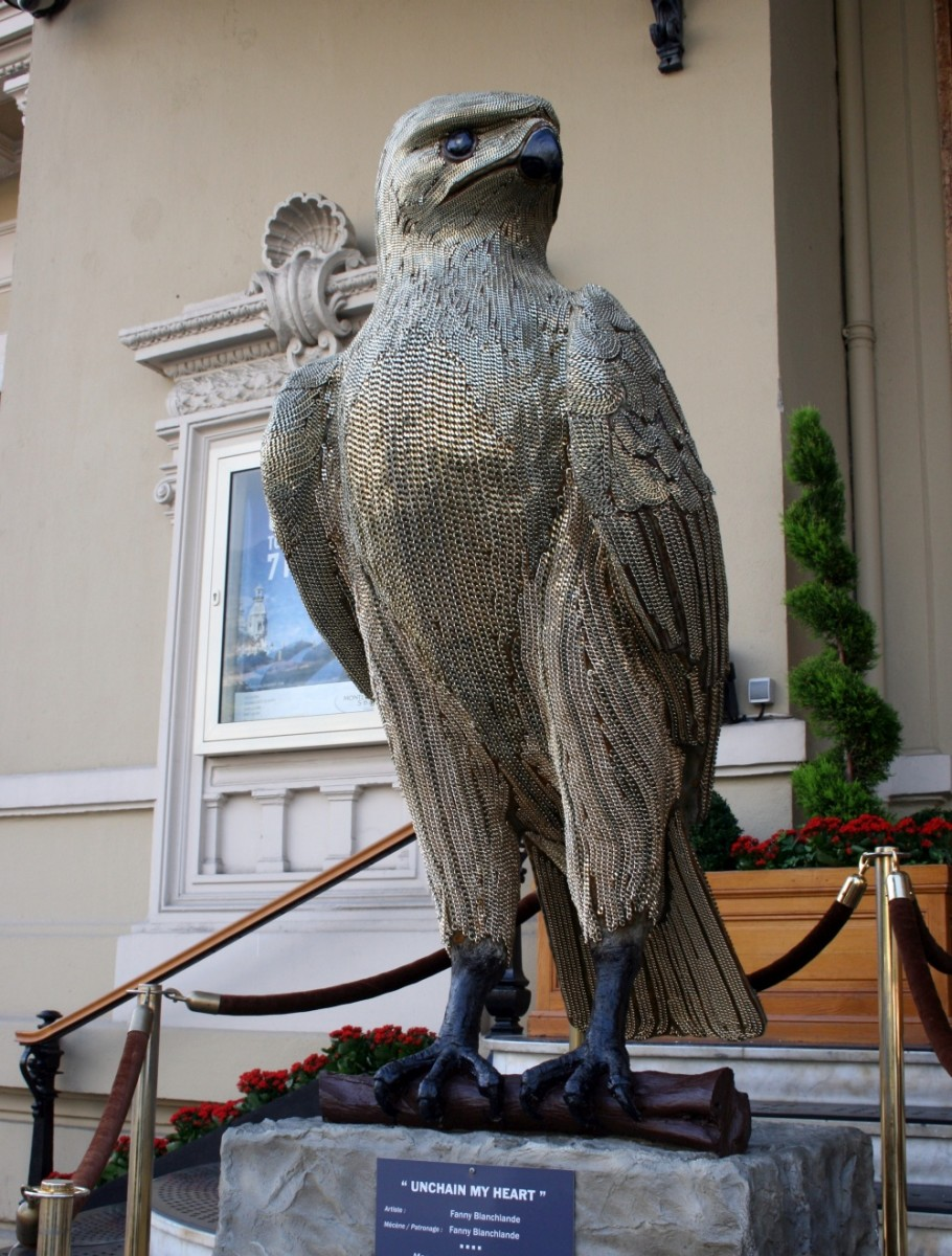 """""""Unchain my heart"""", a large eagle sculpture covered in chainmail"""