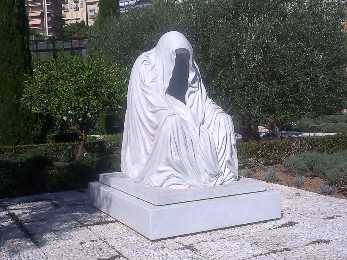 The Cloak of Conscience, a massive sculpture in white marble by Anna Chromy.