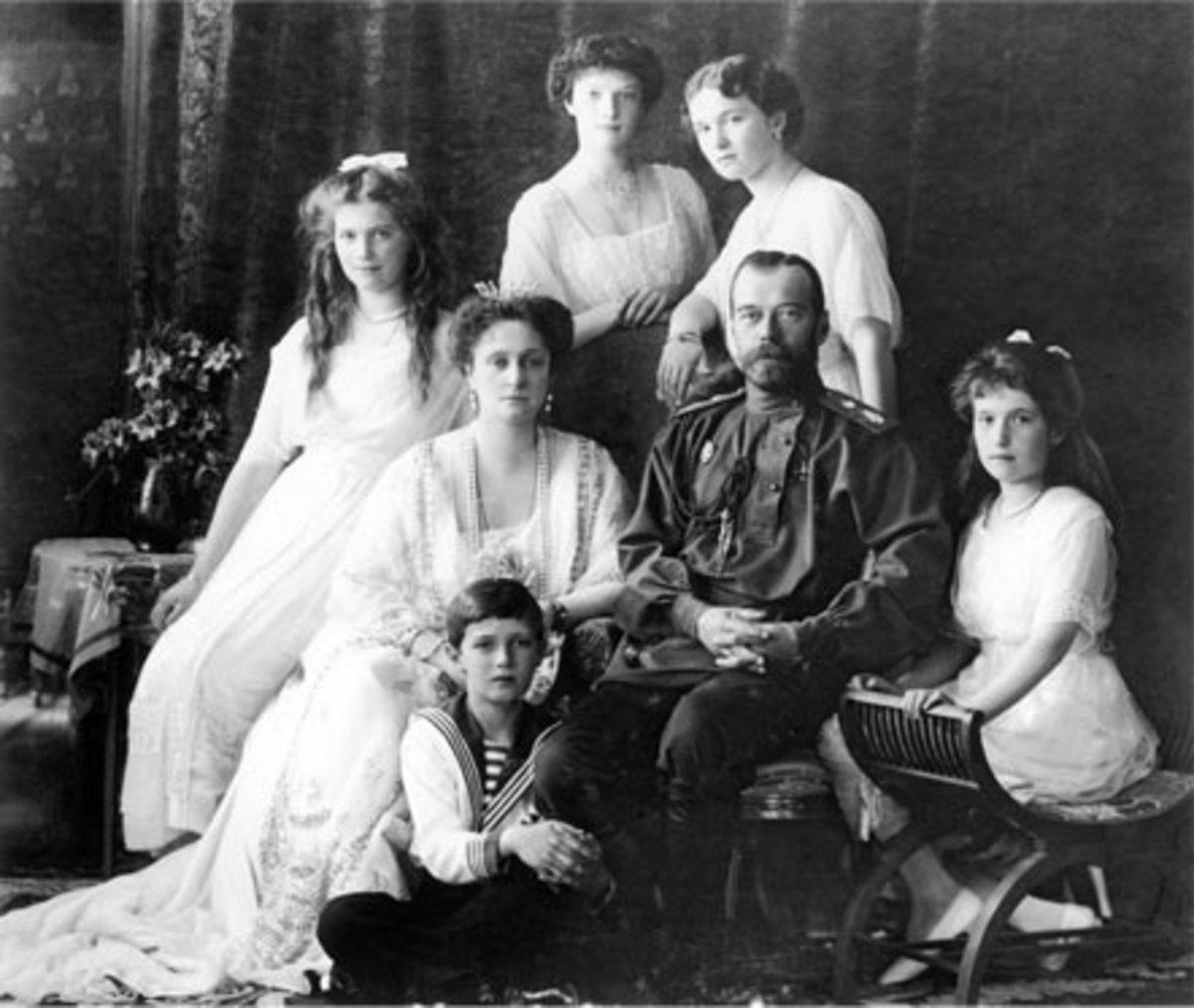 The last Russian Imperial Family.  Left to right standing:  Grand Duchess Tatiana, Grand Duchess Olga.  Left to right sitting:  Grand Duchess Maria and Tsarina Alexandra, Tsarevitch Alexi, Tzar Nicholas II, Grand Duchess Anastasia.