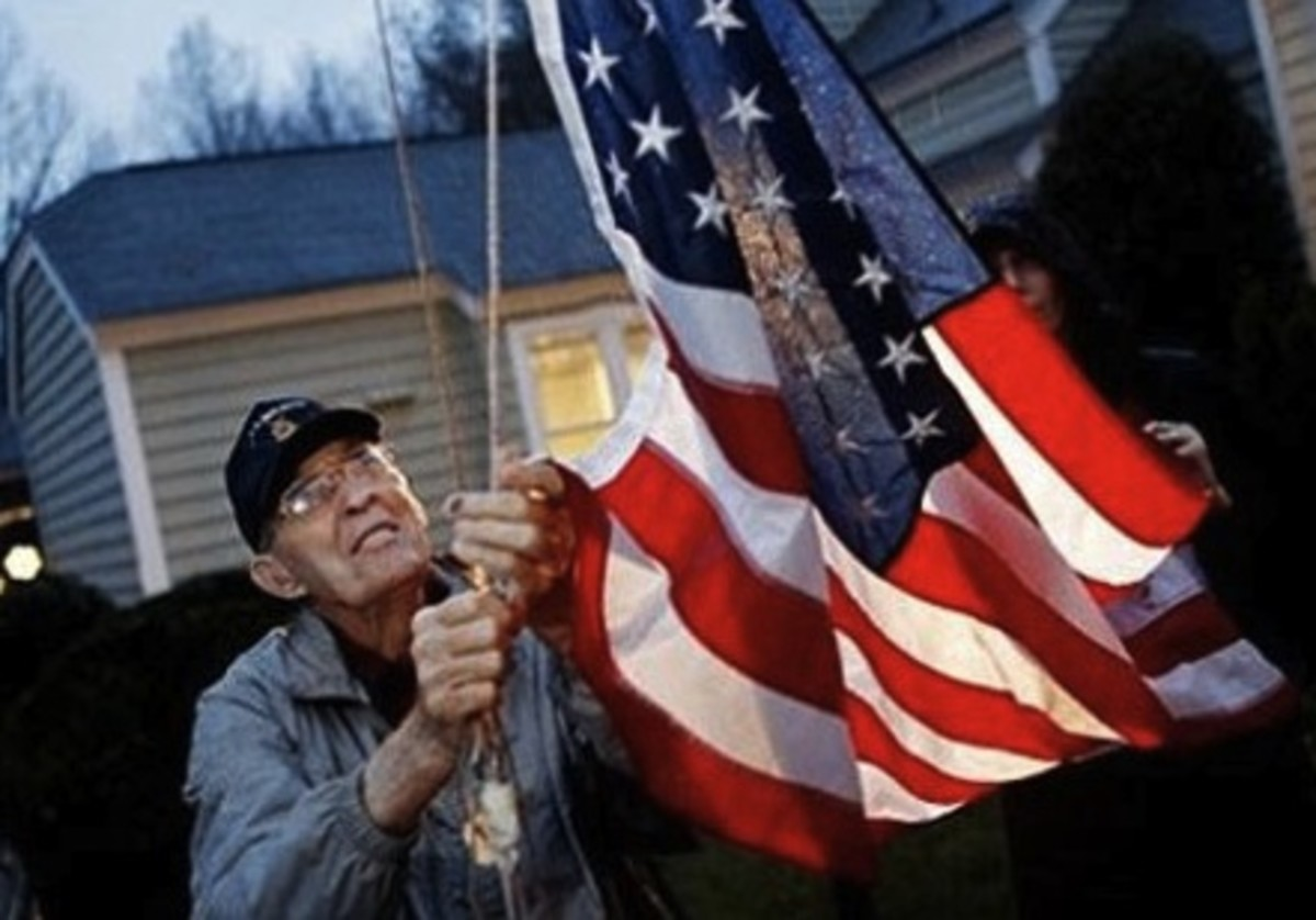 Van T. Barfoot raising his flag at 6 AM as he did every morning.