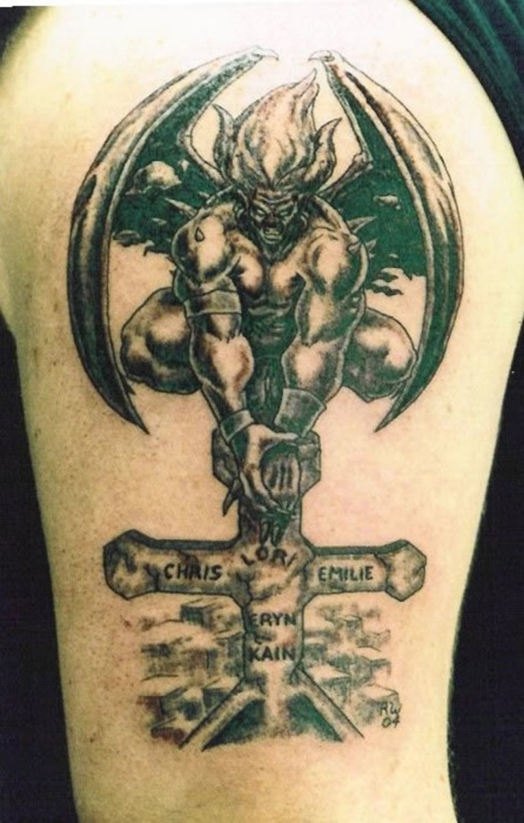 Gargoyle Tattoo Sitting on Top of Cross on ChurchGargoyles Tattoos Meaning