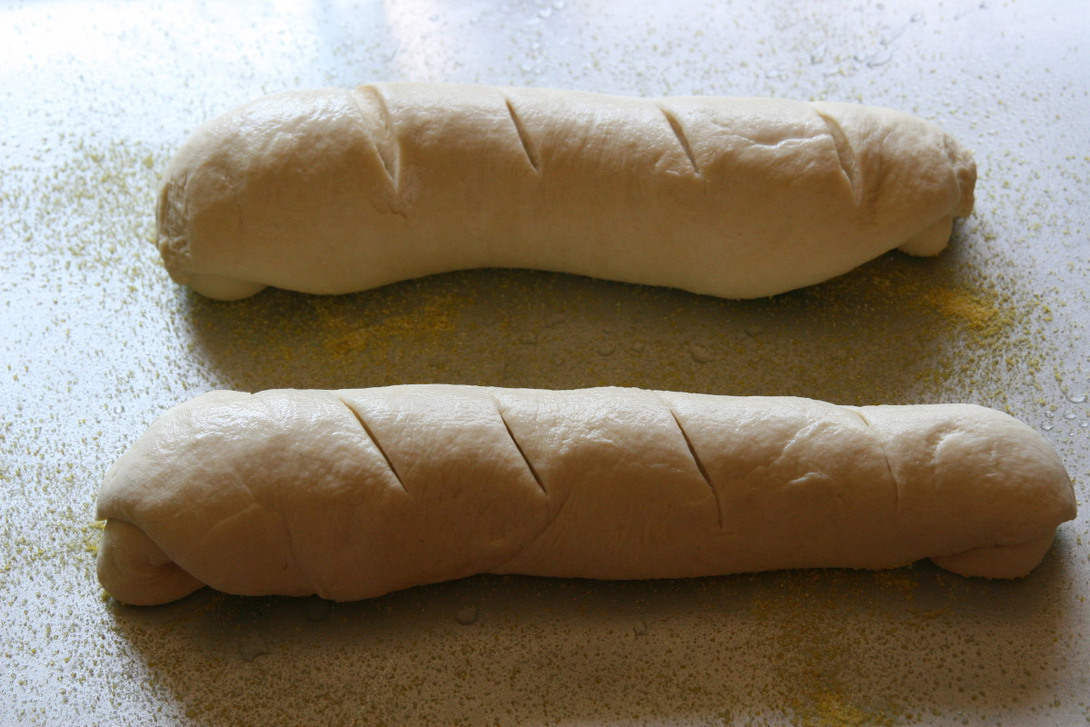 Allow the baguette loaves to rise, uncovered, in a warm location for an additional hour.
