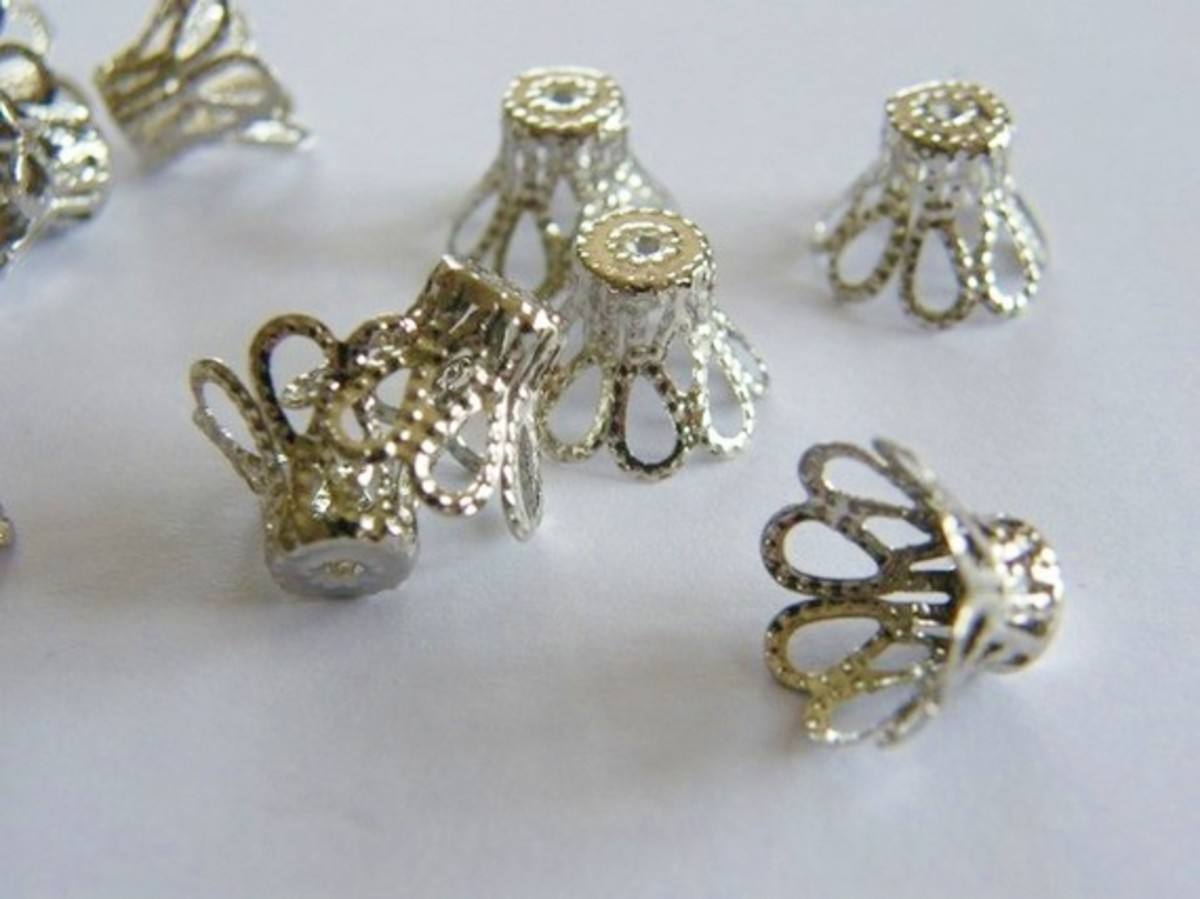 Small Bead Caps. Beautiful with lucite flower beads and the perfect spacers between crystals and flowers.