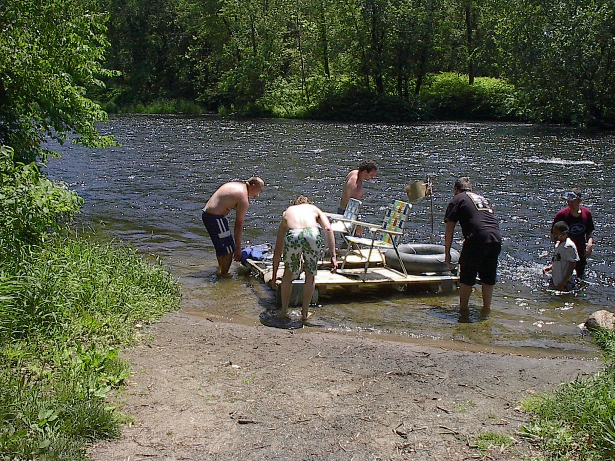 The raft was so heavy we needed 4 people to get it to the edge of the river