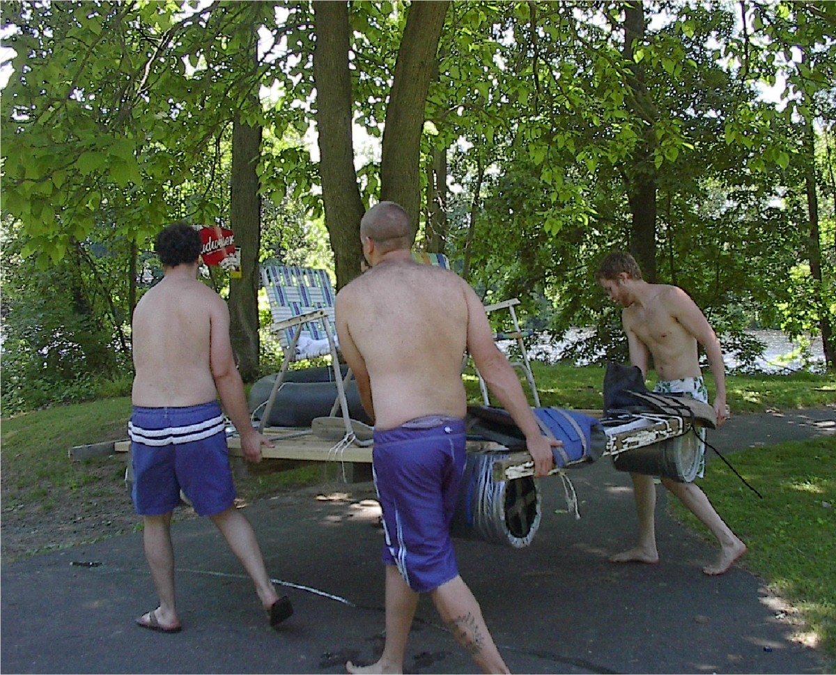 My friends and I carrying our homemade raft to the shore