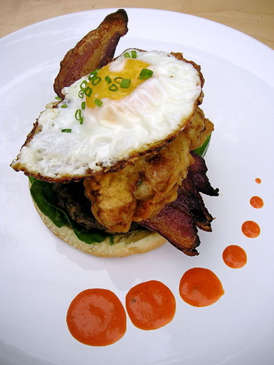 Hangtown Burger with bacon, oysters, eggs fried together over 1/2 burger