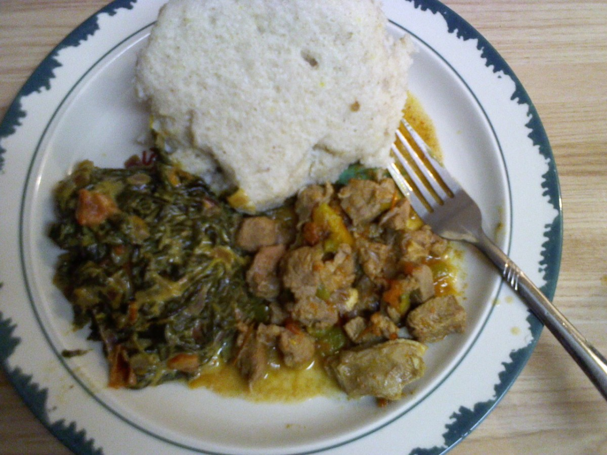 Ugali (white made from corn/maize meal), Isageek (green) & Goat Meat
