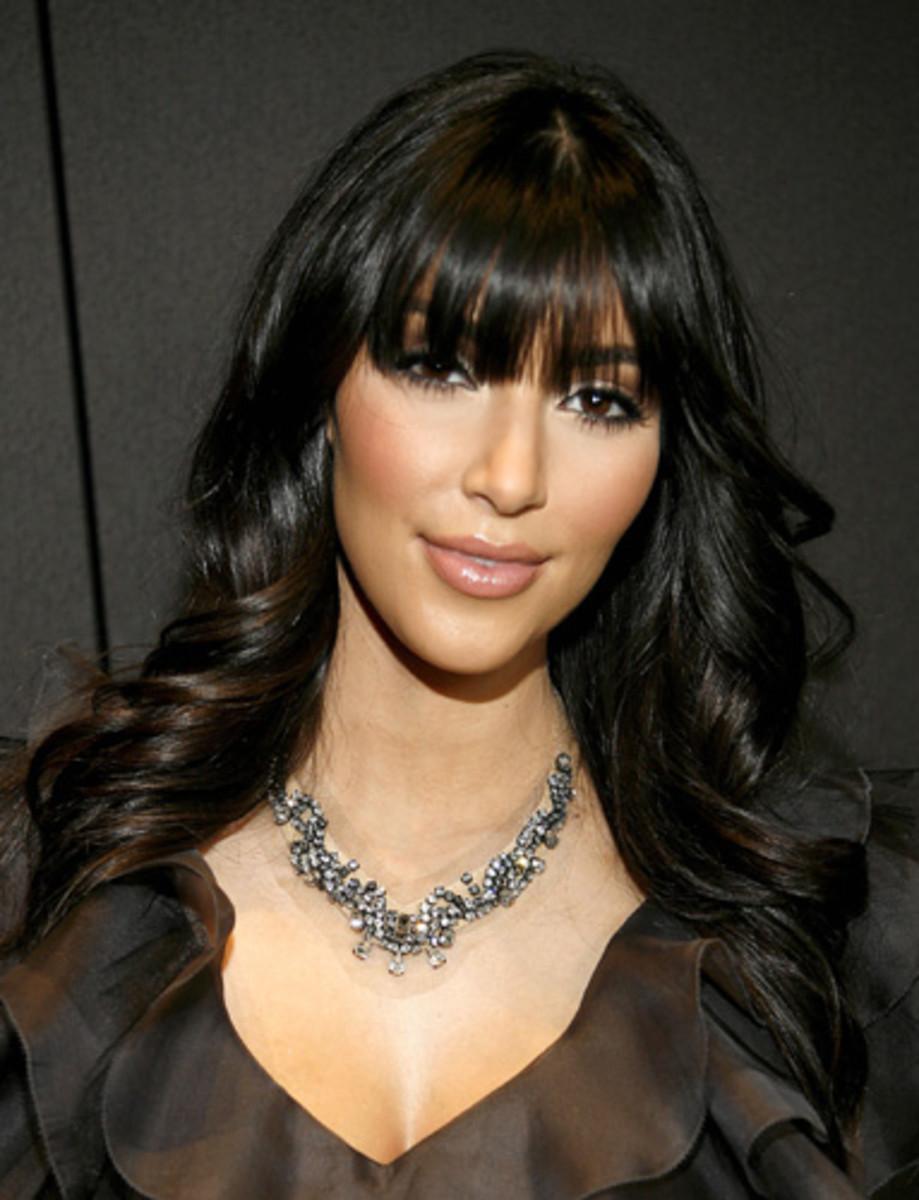 Kim Kardashian in a Cher Hairdo.