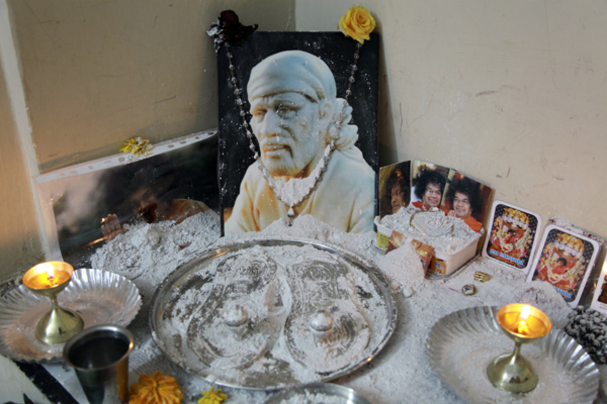 The altar in the room was overflowing with copious amounts of vibhuti