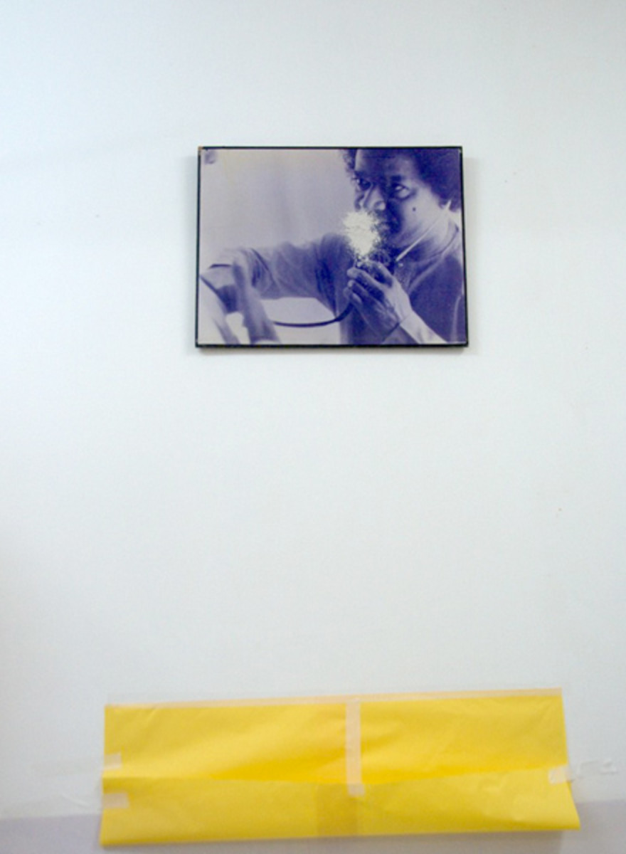 The photograph of Swami with the stethoscope in a ward at Sathya Sai General Hopital which was exuding vibhuti from 8 feet above the ground! A yellow 'collection paper' had been fixed below.