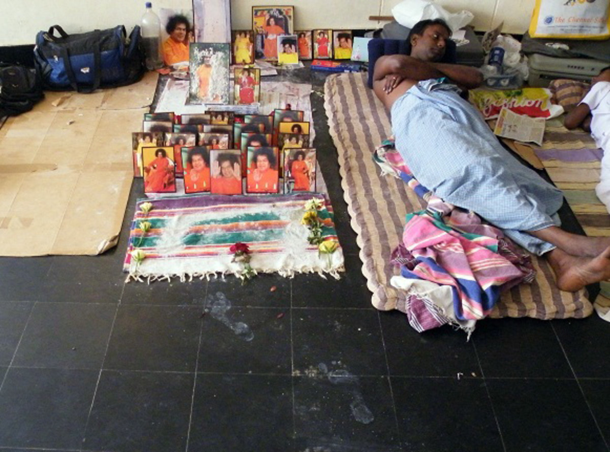 The footsteps lead to this altar where every volunteer had placed a photograph of his choice...