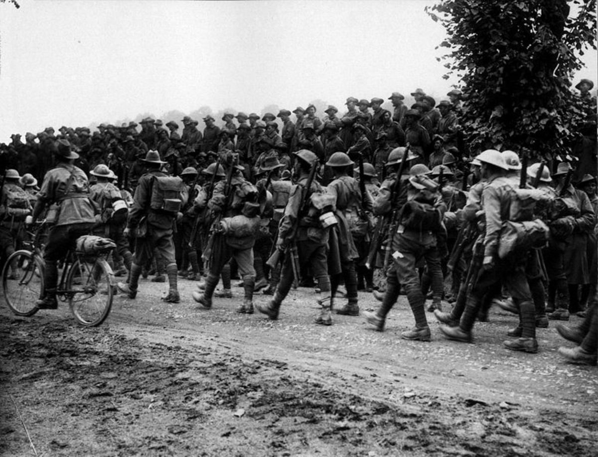 Aussie troops from 6th Brigade marching back to rest billets after the Battle of Pozieres in 1916 with 2nd Brigade watching.  The troops aren't singing; with nearly 2,000 battle casualties it's not surprising.