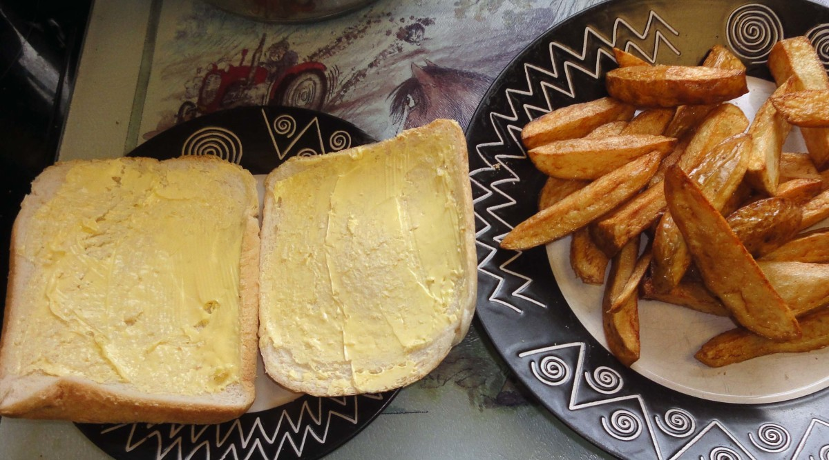 Cook chips and butter two slices of bread, crusts, bap or bread roll.