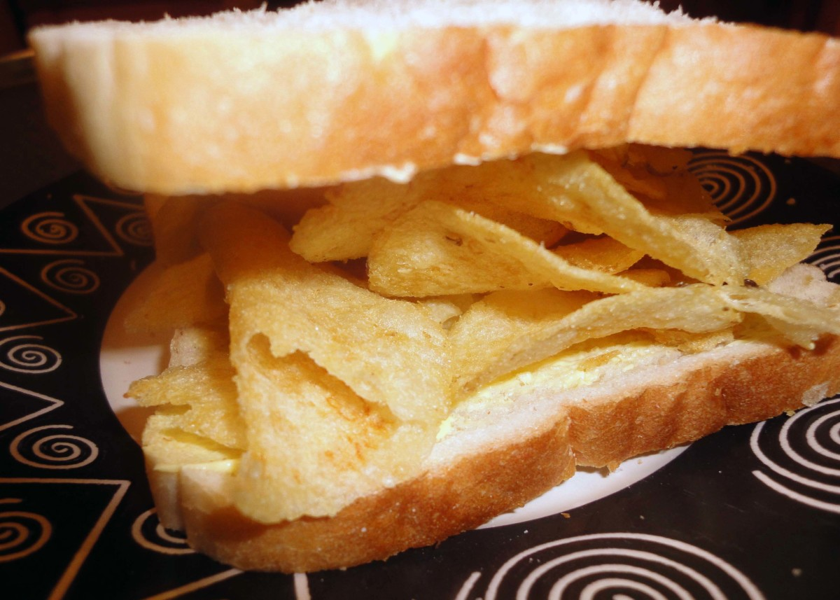 Place the crisps between two slices of buttered bread