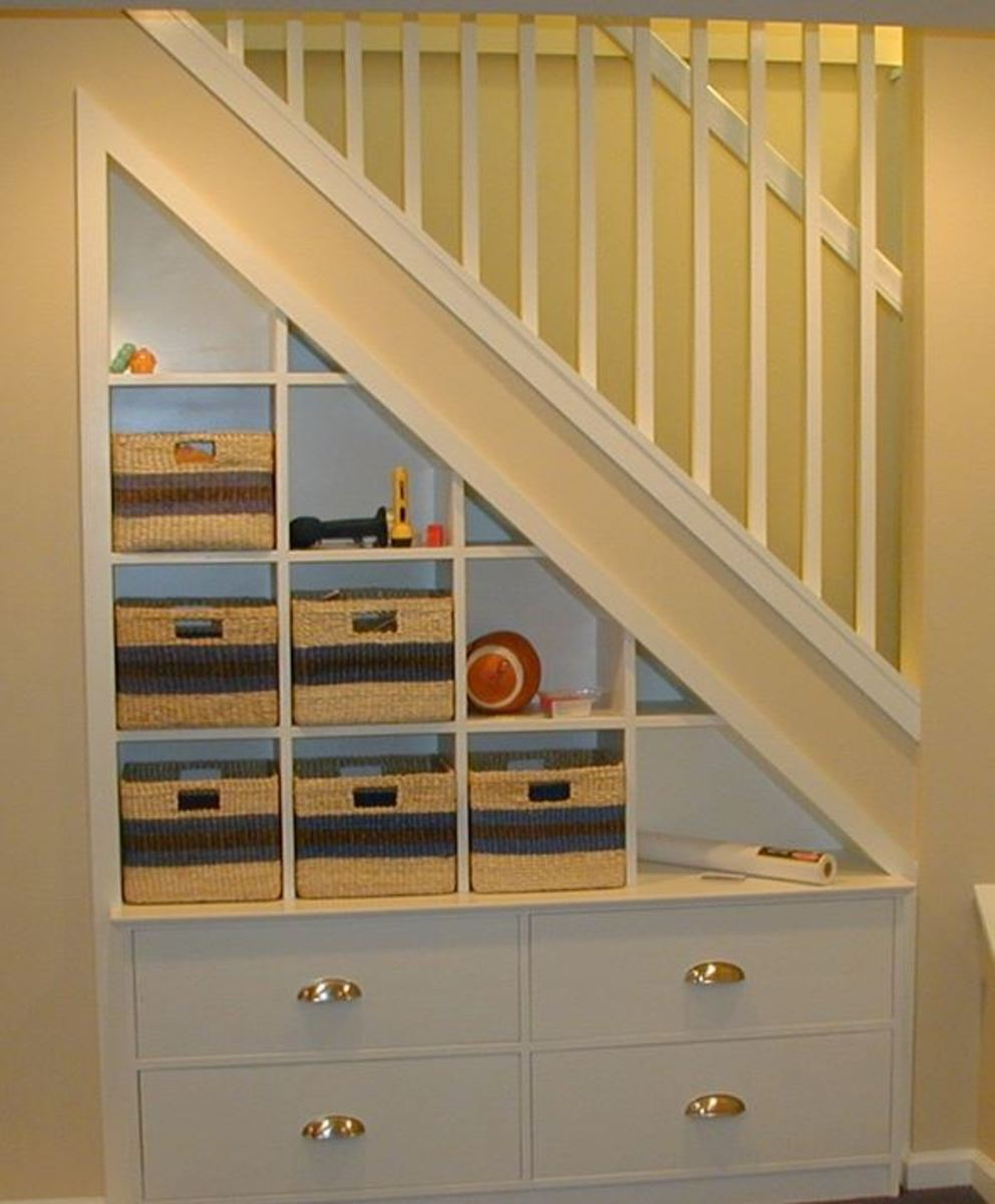 Beautiful under the stairs storage with cup drawer pulls and wicker baskets
