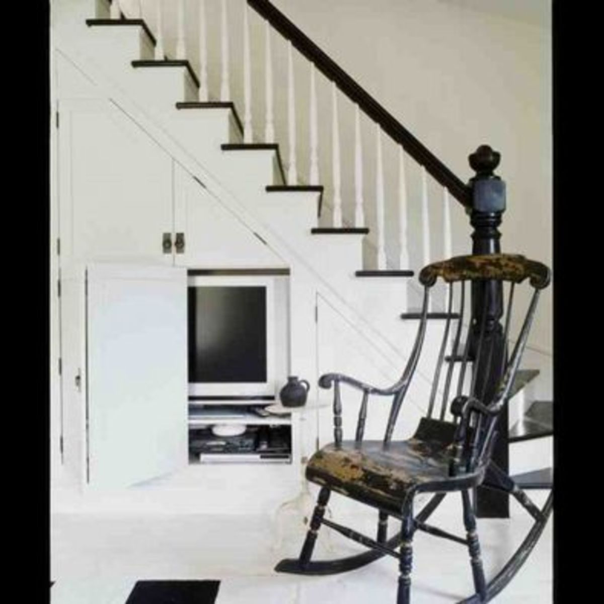 Creative Storage Underneath the Stairs - store and hide your television