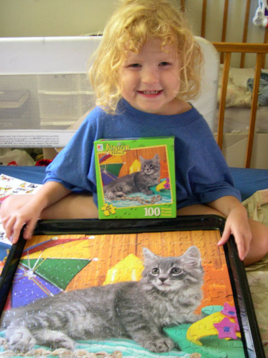 Child with jigsaw puzzle.