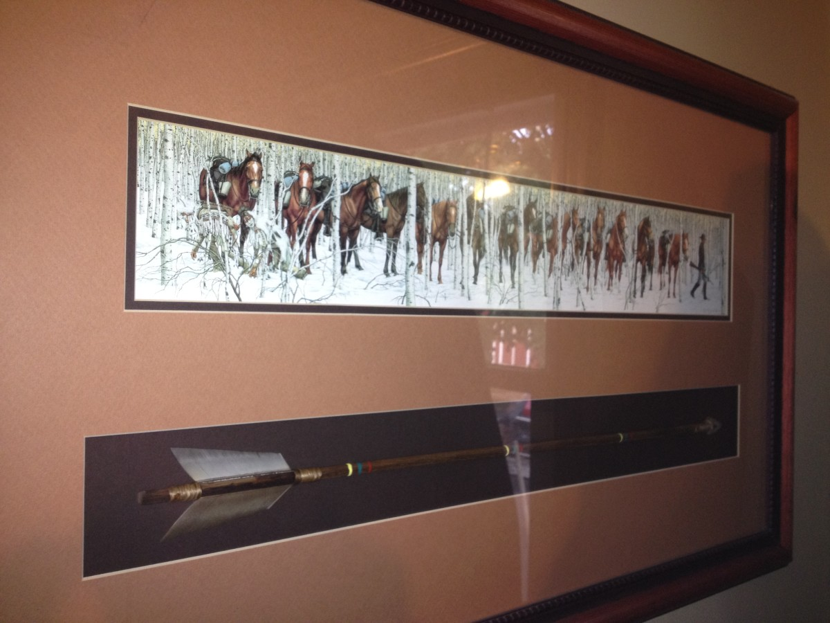 "Doolittle's artwork can be framed to highlight its connection to nature. My copy of ""Two Indian Horses"" was matted with an arrow mounted below the print."