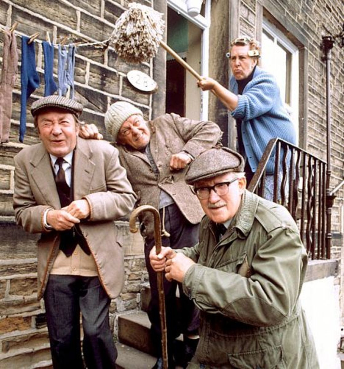 Compo & Co -  Norah Batty conducting her usual 'sorting out' with her trusty mop . Left-right: Peter Sallis, Bill Owen, Brian Wilde, Kathy Staff at rear.  Peter Sallis more recently did the voice of Wallis, the cheese-loving owner of clever Gromit