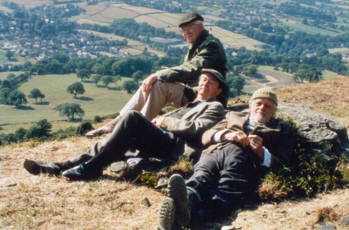 'Foggy' Dewhirst (Brian Wilde), Norman 'Cleggy' Clegg (Peter Sallis) and 'Compo' Simmonite (Bill Owen) at rest during filming near Holmfirth. Bill and Peter were buried side-by-side in the churchyard by agreement.