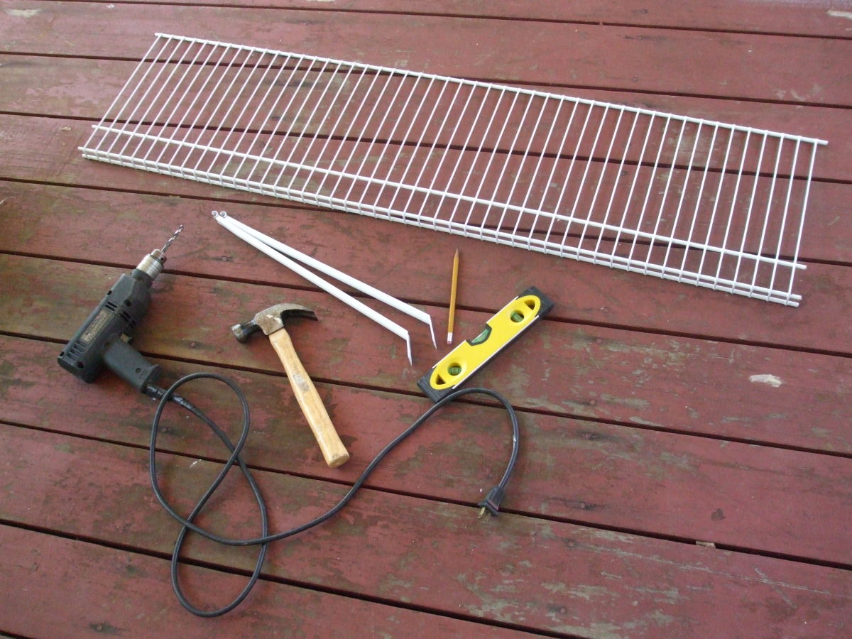 some of the tools and supplies for installing a window cat shelf.