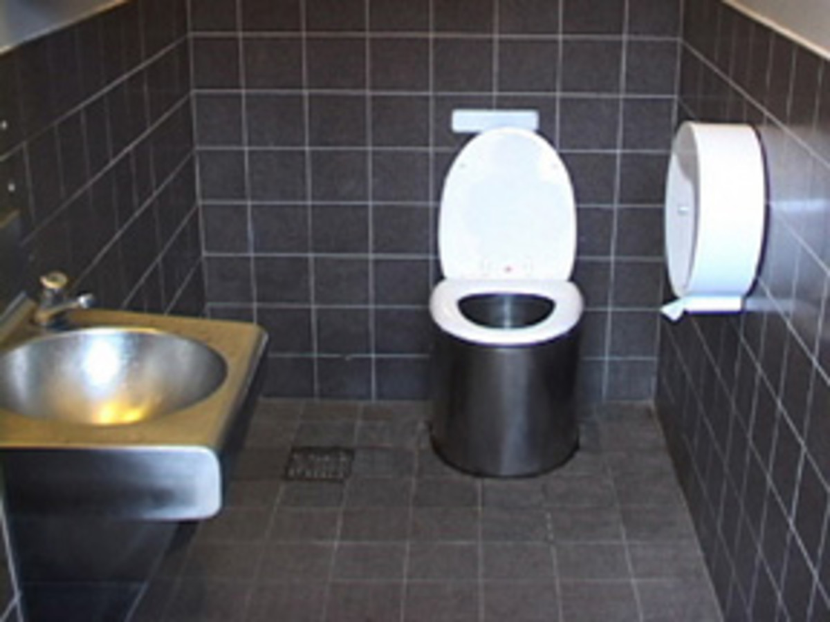 Composting toilet in a public restroom in Sweden. Note that any drugs a person has taken are burned off in this kind of system.