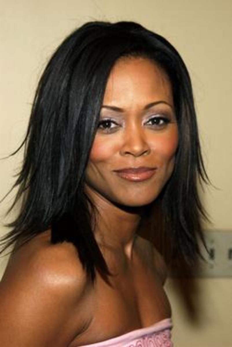 Robin Givens in a long, razored weave.