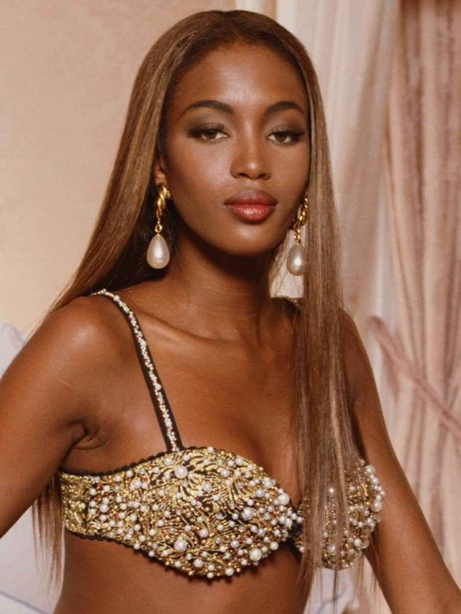 A young Naomi Campbell in a long, straight sandy blonde weave.