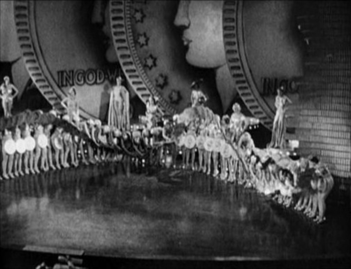 "Gold Diggers of 1933 in the musical number ""Dance of the Dollars."" The dancers are holding large coins and doing a ""wave."""