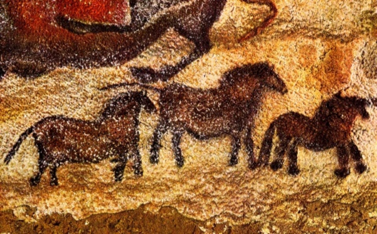 Three tiny horses painted on one of the Lascaux cave walls in southwestern France. Horses are the most common animal to be found on these walls and these paintings are well over 16,000 years old.
