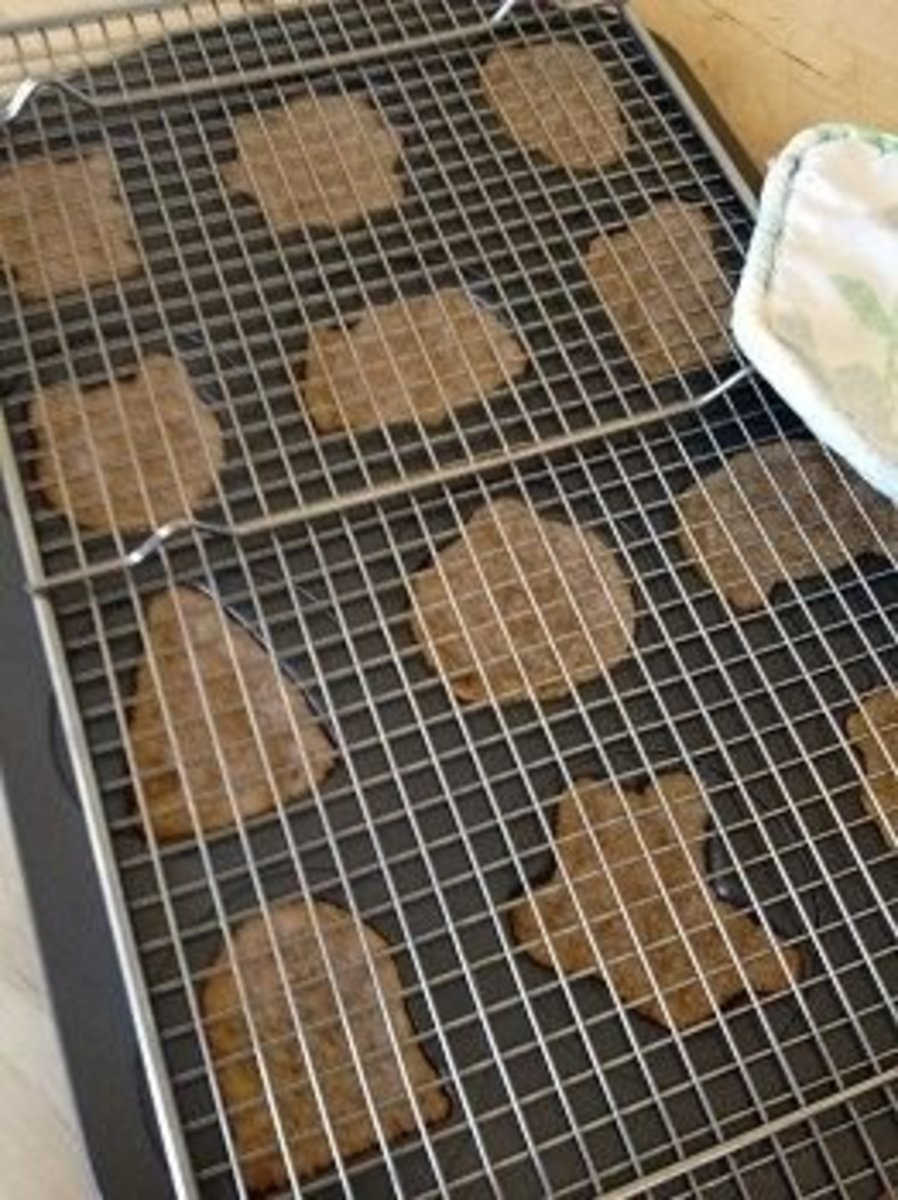 Invert a large baking rack over Wilton cookie pan