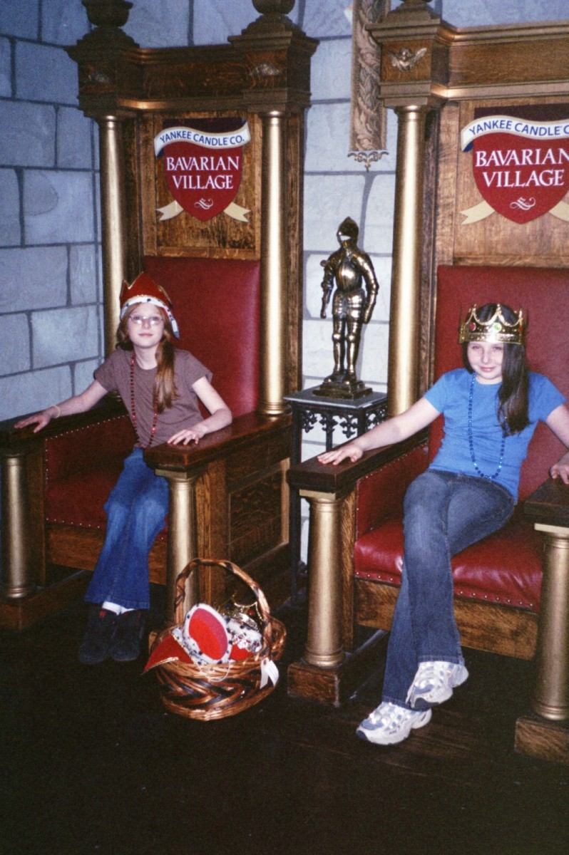 My daughters enjoying the King and Queen's thrones, complete with crowns!