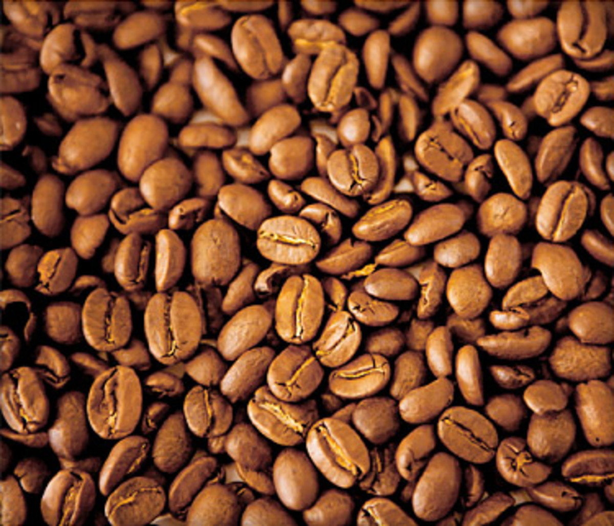 "Close up of coffee beans on webmd article about health benefits of coffee. IT says ""Coffee also contains minerals such as magnesium and chromium, which help the body use the hormone insulin, which controls blood sugar (glucose)."""