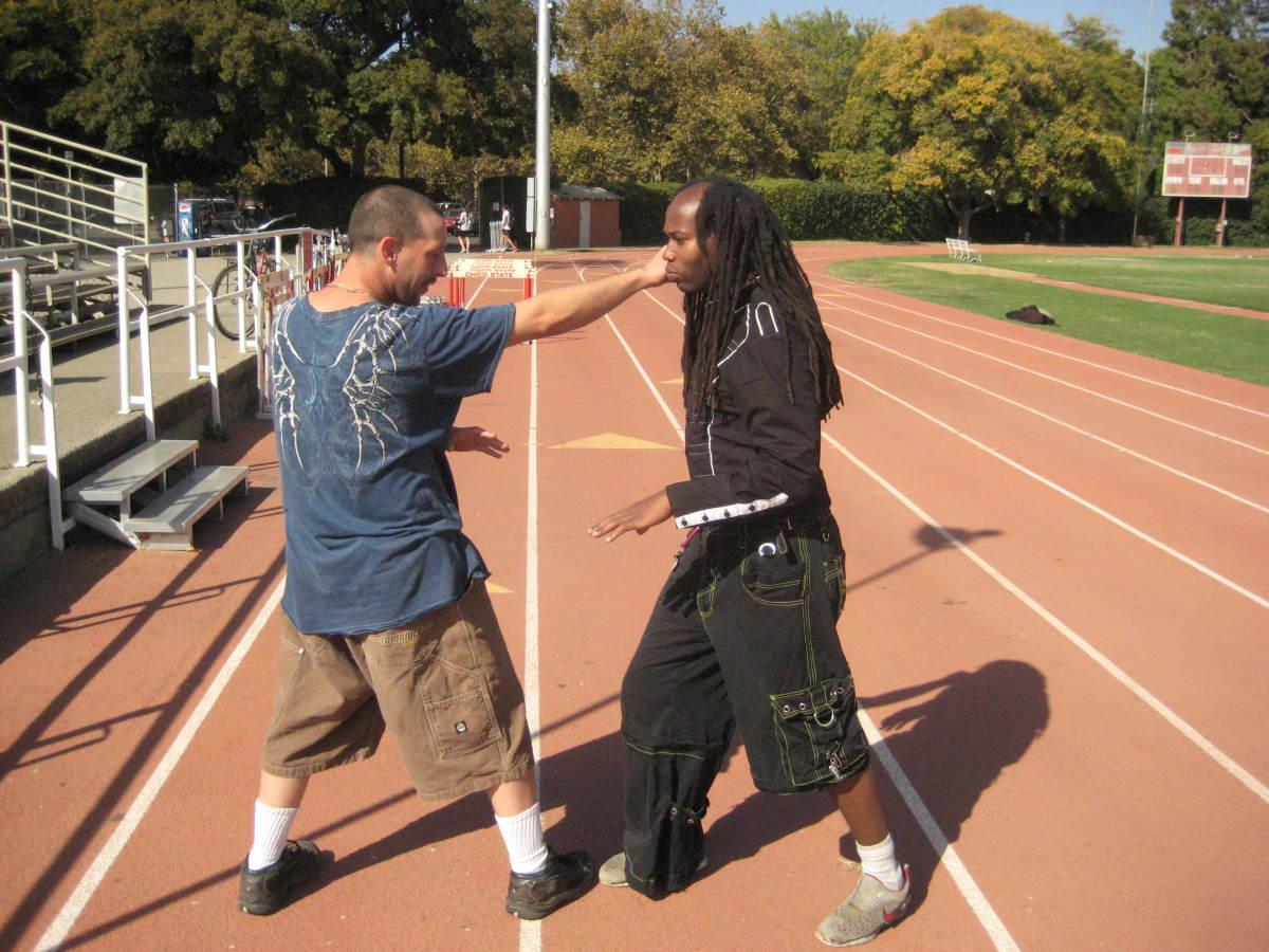 Jamie hits Glenn before he can initiate an attack.