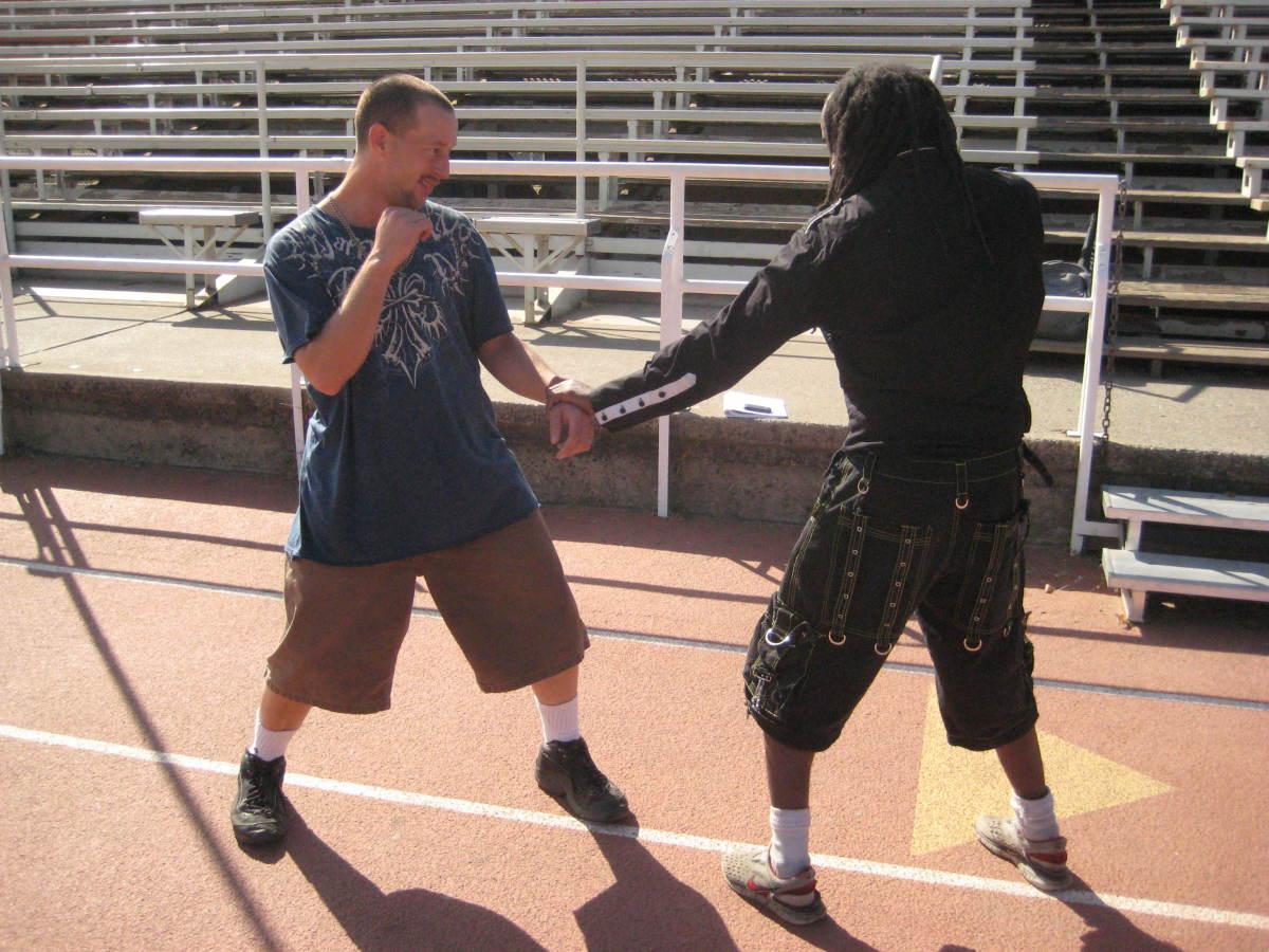 Glenn grabs Jamie's wrist