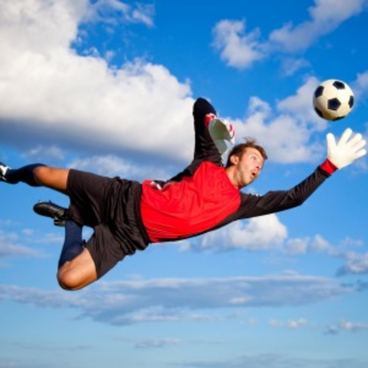 Flying soccer player wearing baggies