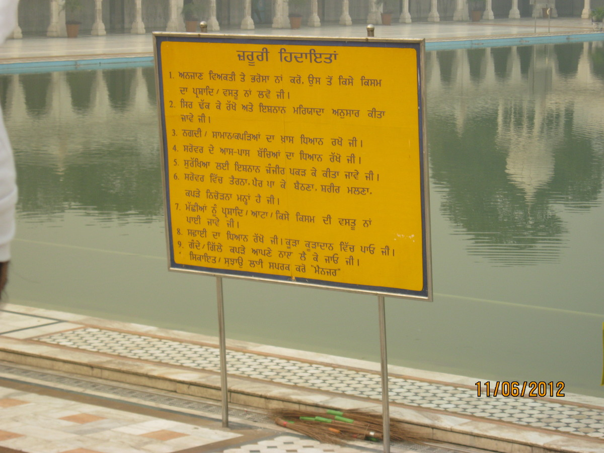 The board near the sarovar outlining the safety and other rules to be followed here.