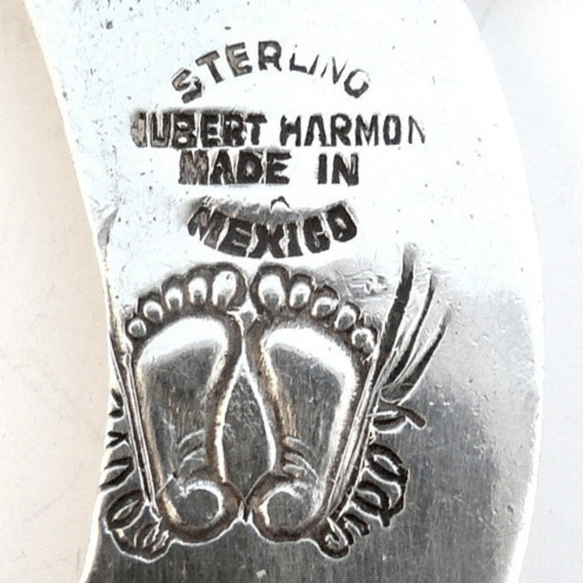 Close up of Hubert Harmon's winged feet hallmark