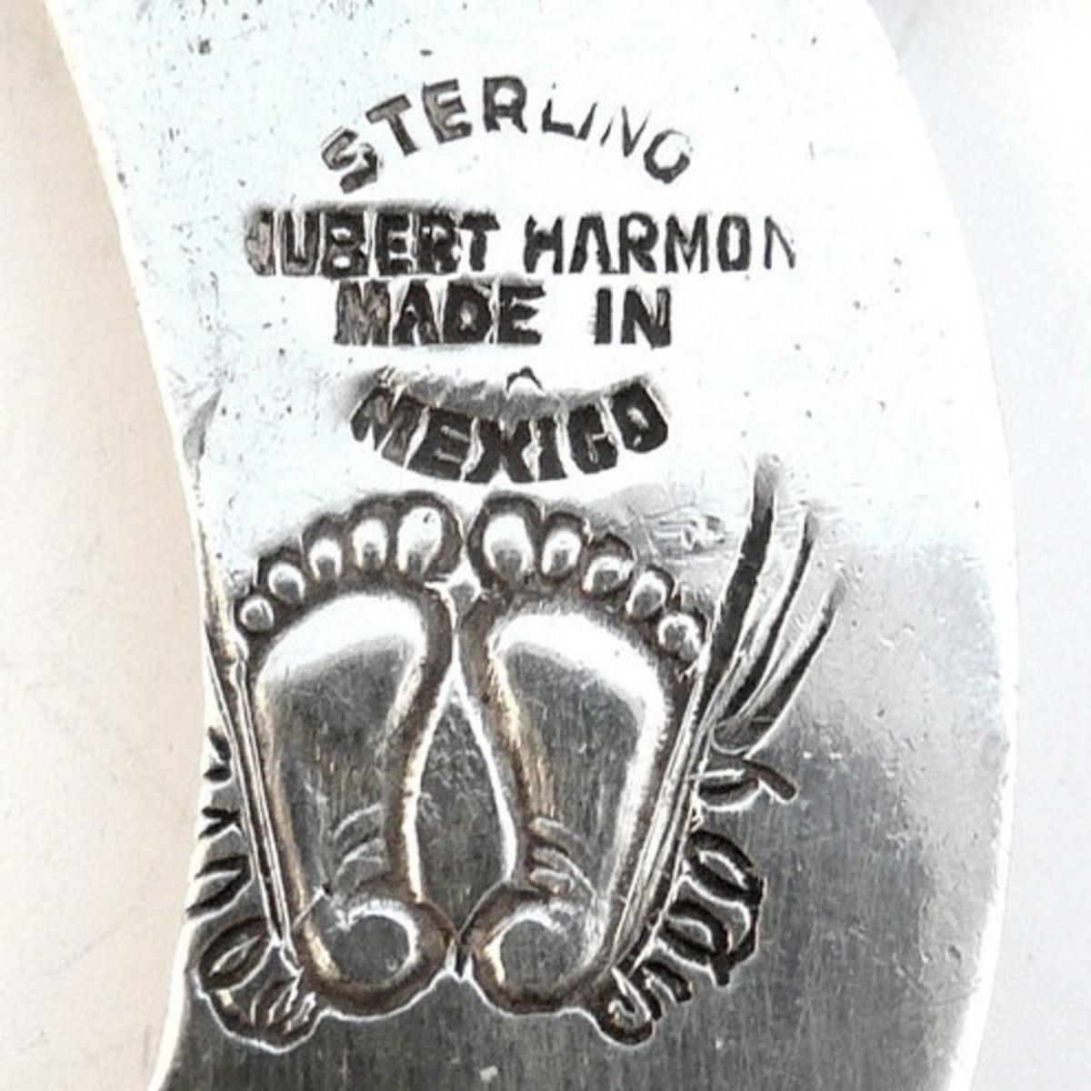 Close up of Hubert Harmon's winged feet hallmark
