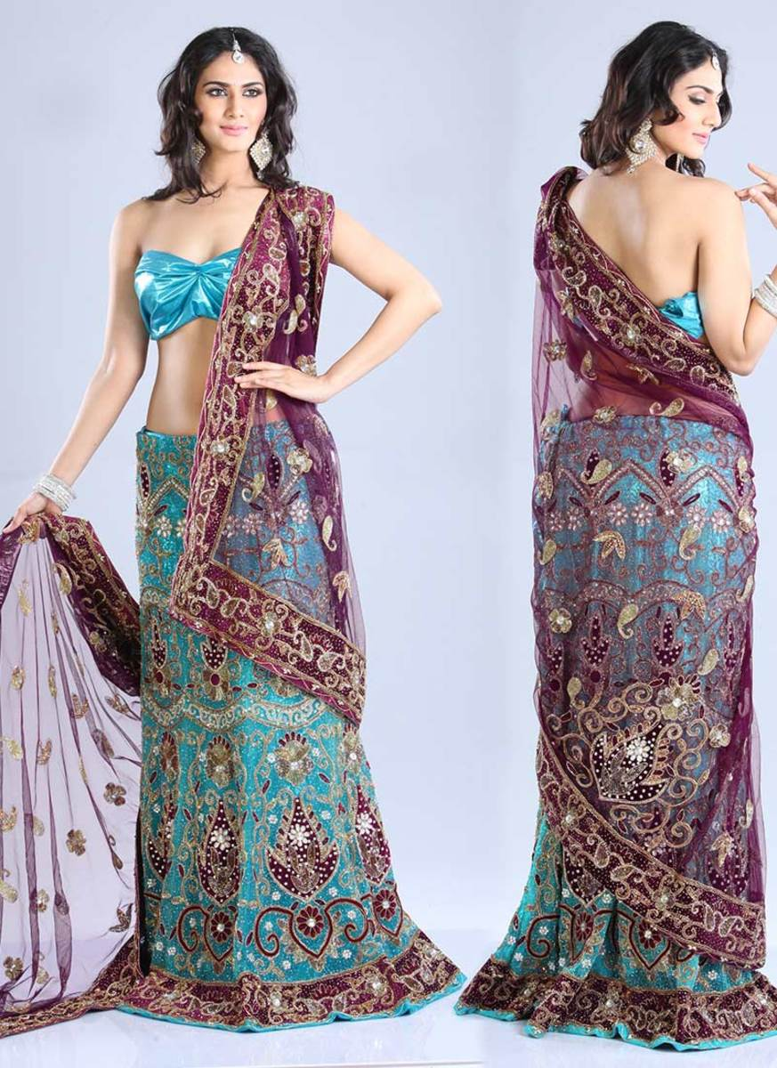 Beautiful Turquoise Net Lehenga Choli. Photo courtesy of Cbazaar.com.