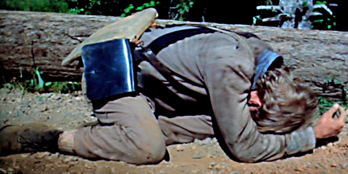 A 16 year old soldier lies crumpled on the ground. But he has not been shot. Rather he is distraught after acting hastily and shooting someone by mistake. Such is war.