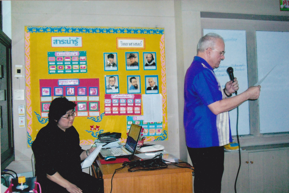 The author working with a Thai teacher at Saint Joseph Bangna School in Thailand in 2014.