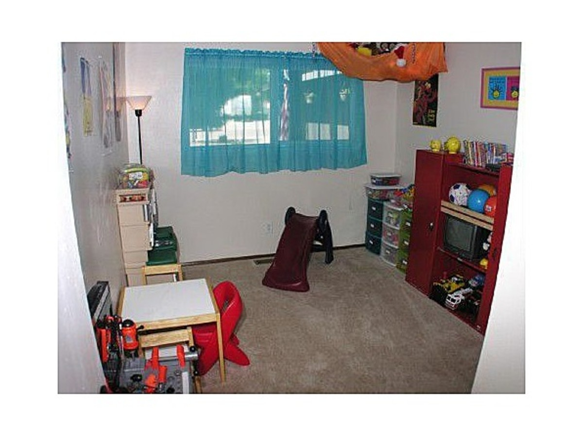 The Kids' Old playroom. This day, they were gone for the photographer. But usually, this room was the last vacated for a showing.