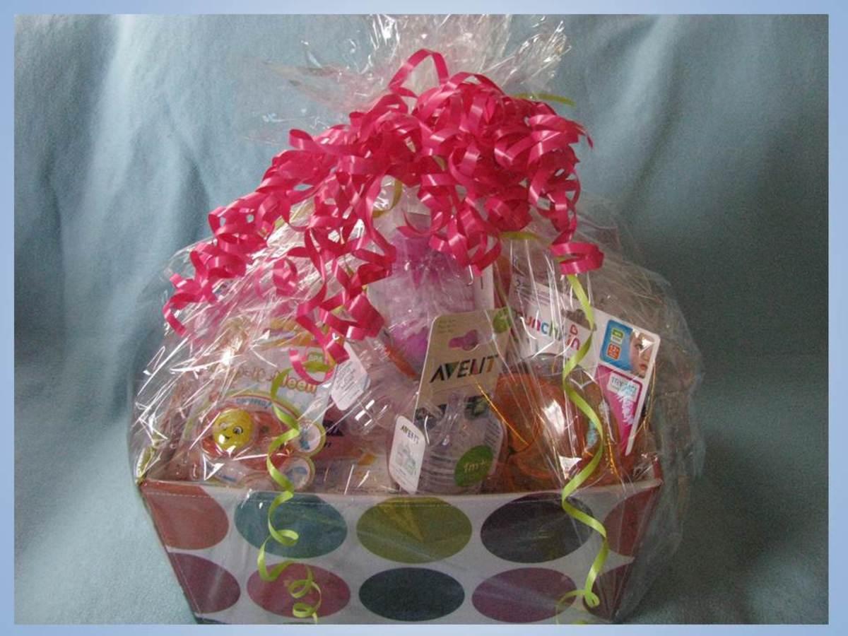 A finished baby shower gift basket.