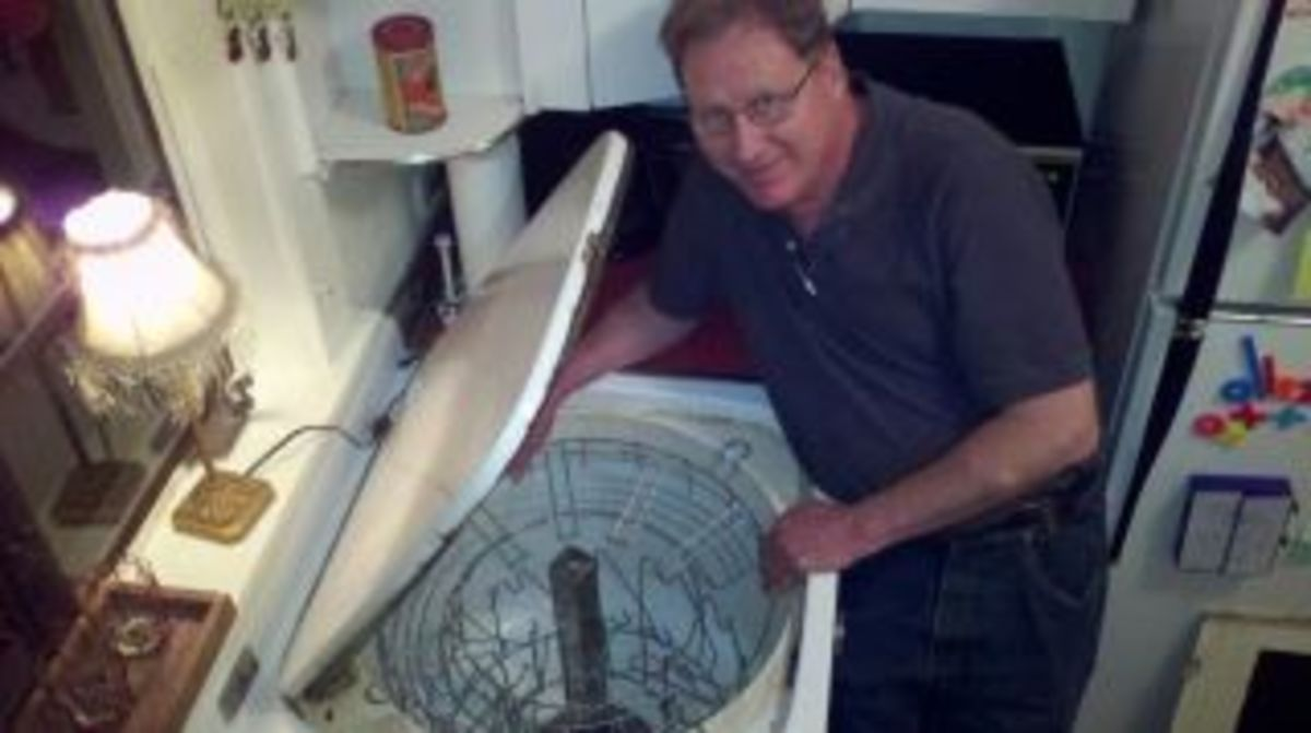 Mike Haller, the owner of the largest collection of antique dishwashers in the US, inspects a Youngstown Electric Sink in my kitchen.