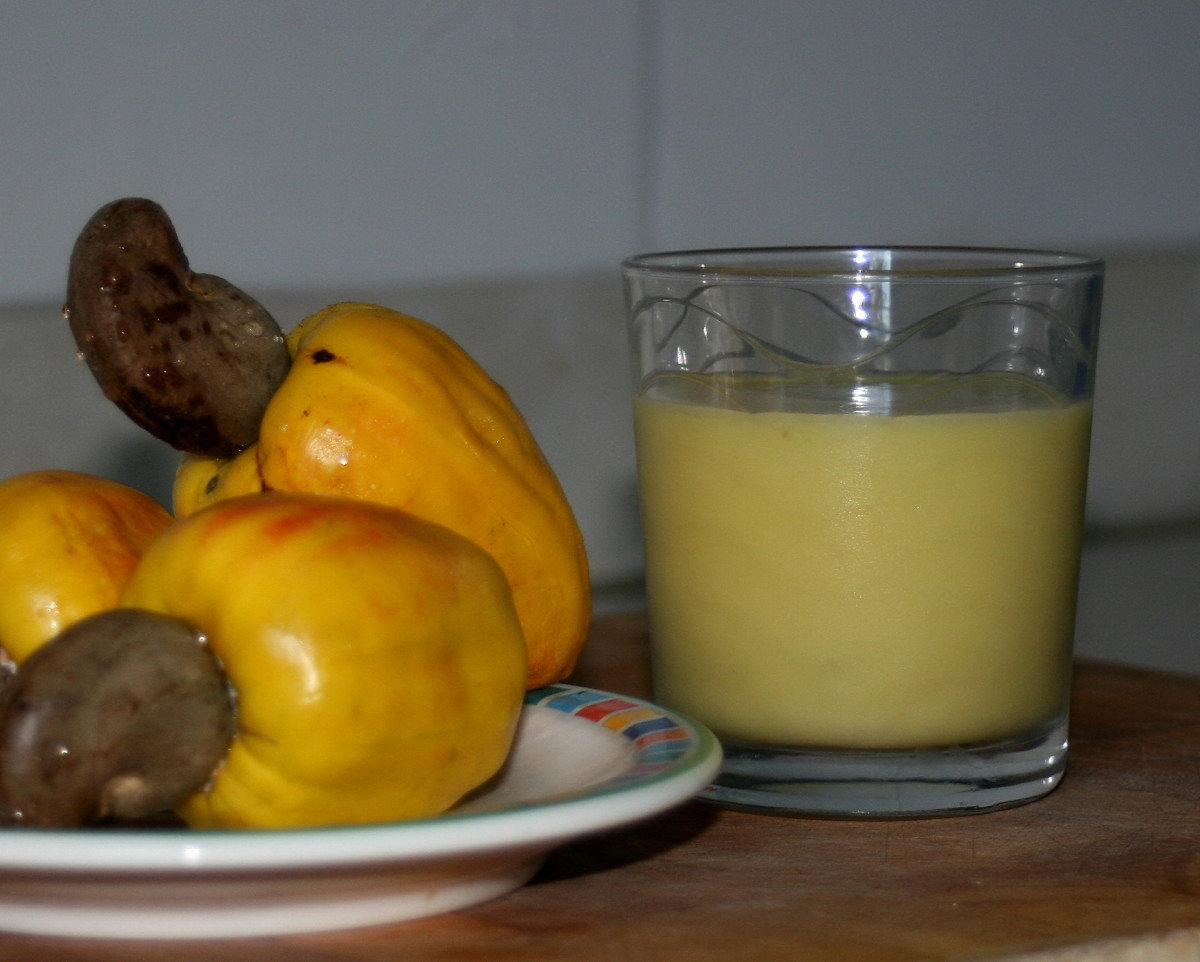 Cashew fruits with nuts attached and cashew juice