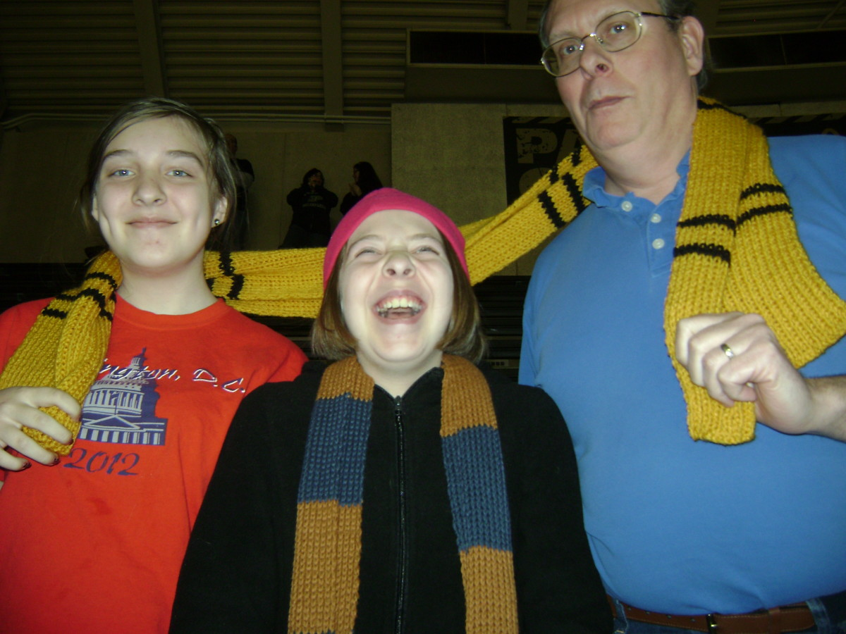 Ravenclaw scarf in middle, with Hufflepuff scarf around them all