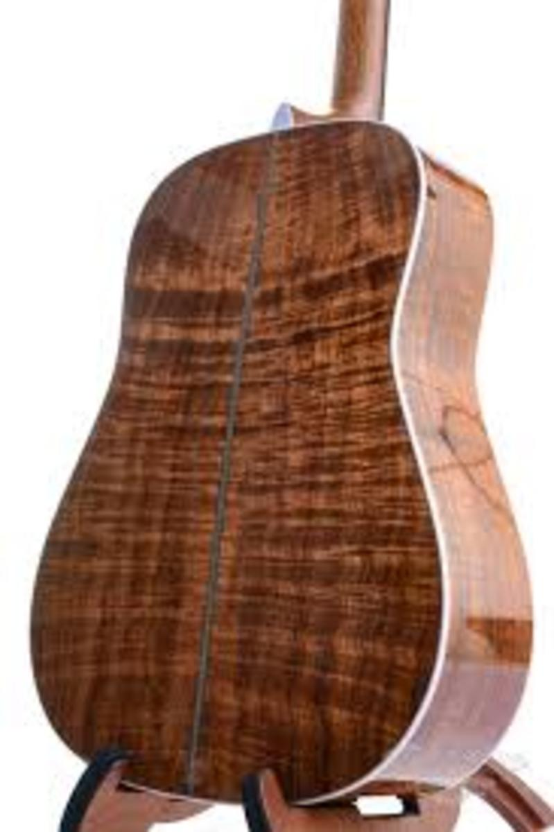 Beautiful Koa backside of a Martin Custom Koa Dreadnought guitar.