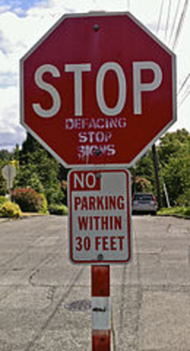 A visual tip of the hat to irony.  While I DO NOT SUPPORT defacing stop signs, I must admit that this is one of the best visual representations of irony I have ever encountered.