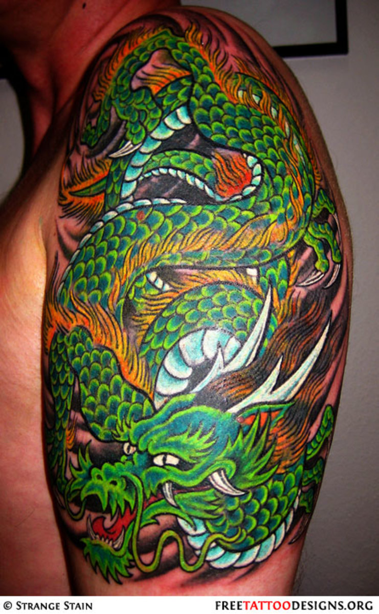 Green arm piece dragon tattoo